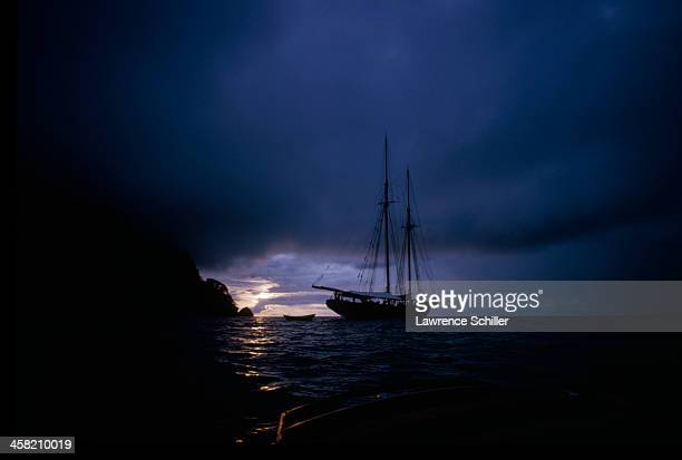View of the fishing schooner Bluenose II at sunrise near Cocos Island off the coast of Costa Rica 1964