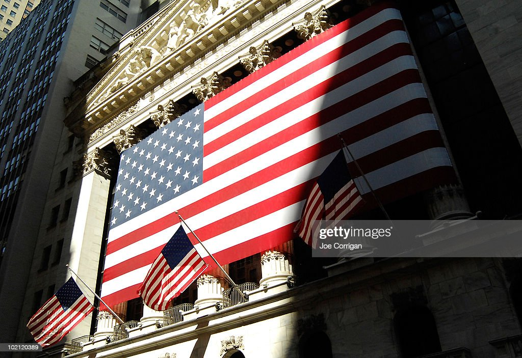 A view of the flags that hang outside of the New York Stock Exchange on June 15, 2010 in New York City.