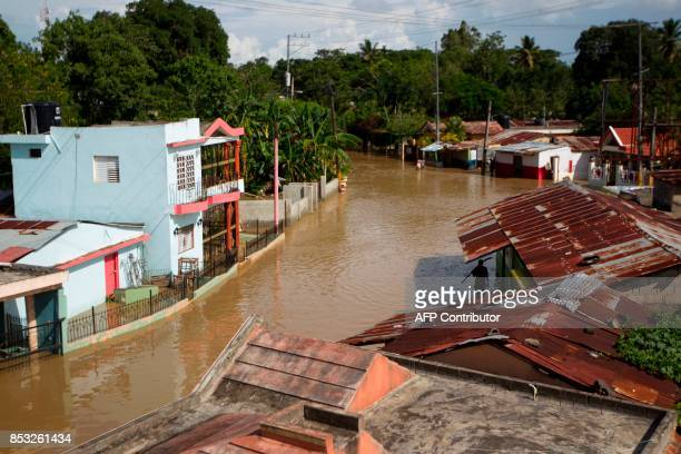 TOPSHOT View of the flooded streets of Arenoso northeastern Dominican Republic on September 24 2017 after the passage of Hurricane Maria The storm is...