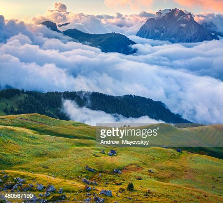 View of the foggy Val di Fassa valley : Stock Photo