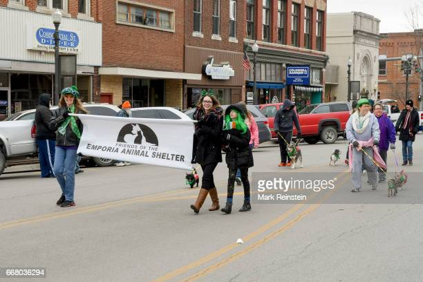 View of the Friends of the Emporia Animal Shelter with a number of dogs as they march in the annual Saint Patrick's Day Parade Emporia Kansas March...