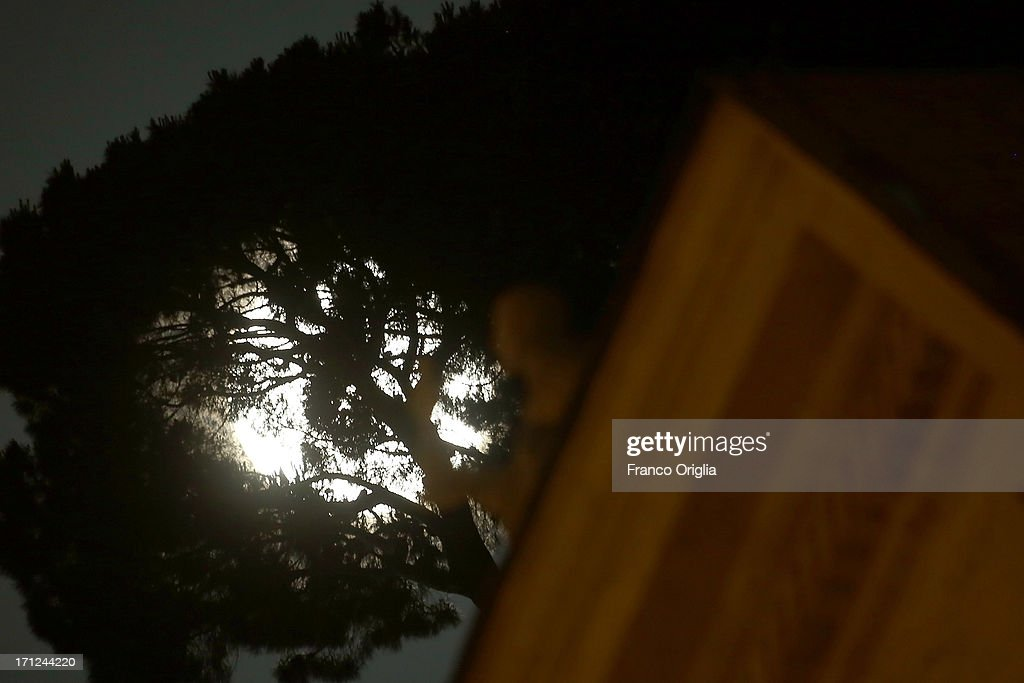 A view of the full moon framed by a pine and the colonnade of St. Peter's Square on June 23, 2013 in Rome, Italy. Tonight a pink full moon was expected to appear in the sky of Rome. The event occurs once a year when the moon reaches its nearest point to Earth, making it appear much larger than usual as well as being a peculiar shade of pink. The spectacle can be seen throughout the world, weather permitting.