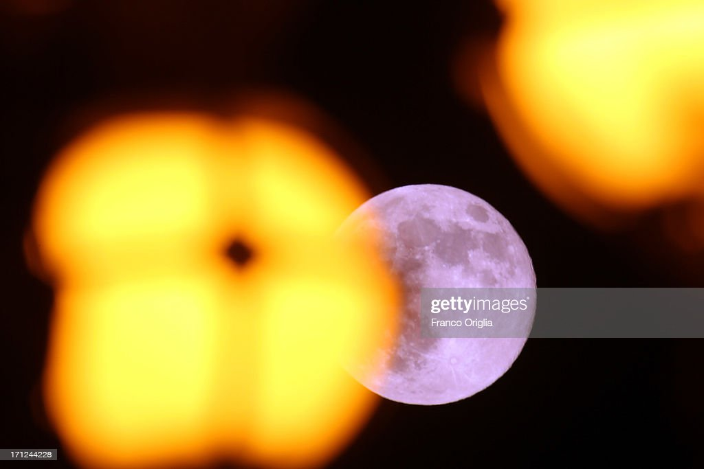A view of the full moon framed by the 19th-century lamp posts around the obelisk of St. Peter's Square on June 23, 2013 in Rome, Italy. Tonight a pink full moon was expected to appear in the sky of Rome. The event occurs once a year when the moon reaches its nearest point to Earth, making it appear much larger than usual as well as being a peculiar shade of pink. The spectacle can be seen throughout the world, weather permitting.