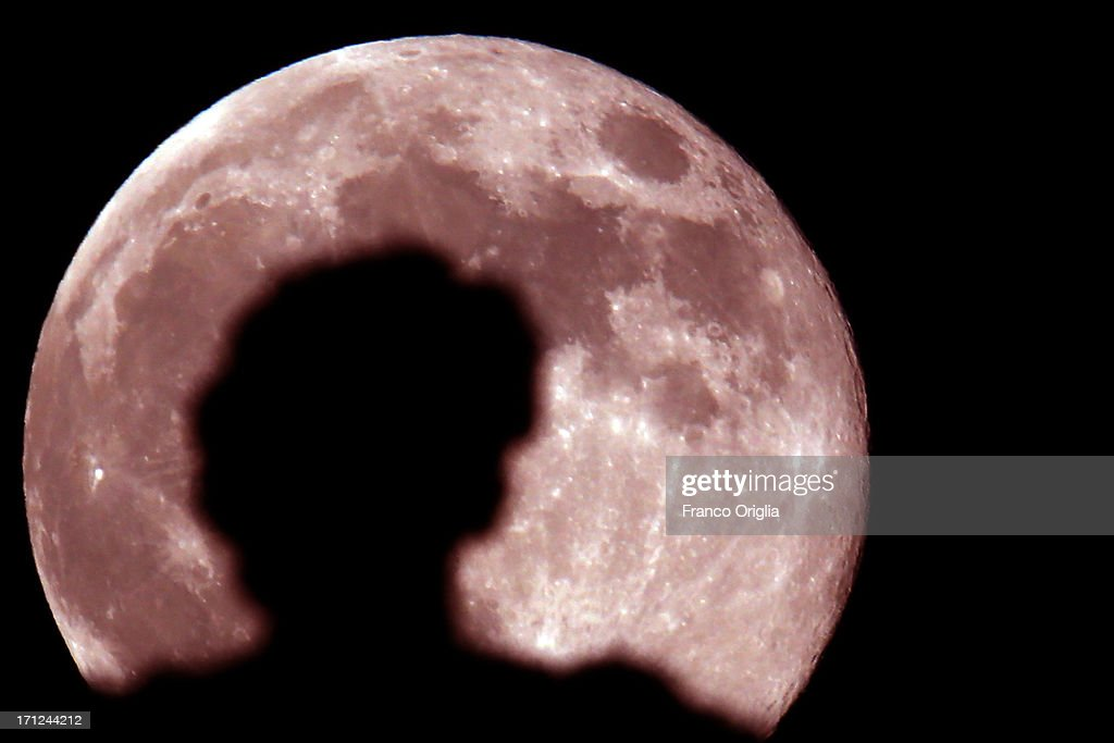 A view of the full moon with a silhouette of the sculpture of the Colonnade overlooking St. Peter's Square on June 23, 2013 in Rome, Italy. Tonight a pink full moon was expected to appear in the sky of Rome. The event occurs once a year when the moon reaches its nearest point to Earth, making it appear much larger than usual as well as being a peculiar shade of pink. The spectacle can be seen throughout the world, weather permitting.