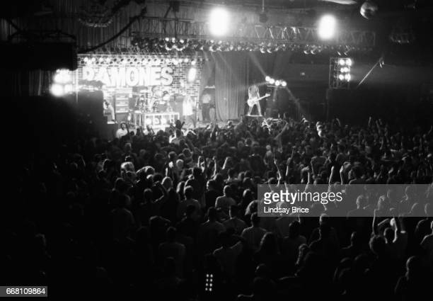 A view of the full stage from the balcony of The Ramones with Johnny Ramone and CJ Ramone standing on crates toward back of stage Marky Ramone on...