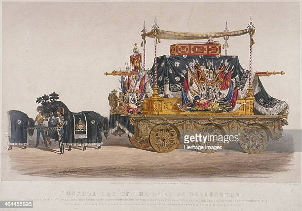 View of the funeral car of the Duke of Wellington 1852 Two horses pull a large hearse containing the coffin covered in flags and banners The carraige...