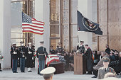 View of the funeral of former President of the United States Dwight D Eisenhower with the President's coffin draped in the flag of the United States...
