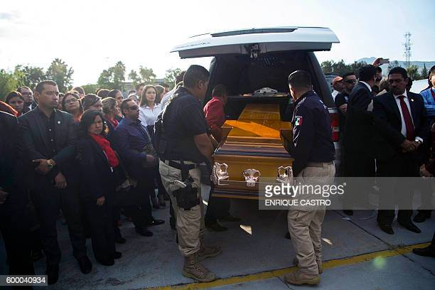 View of the funeral of four policemen who died on the eve in a helicopter crash in Morelia Michoacan state Mexico on September 7 2016 Troops and...