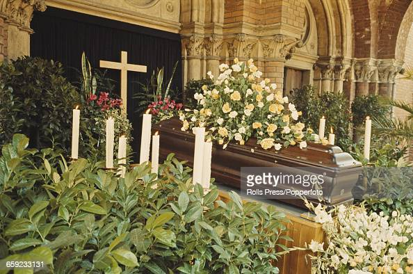 View of the funeral of German born Austrian racing driver Jochen Rindt killed competing in the Italan Grand Prix at Monza with the casket surrounded...