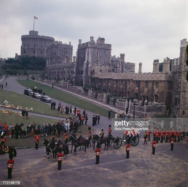 View of the funeral of Harold Alexander 1st Earl Alexander of Tunis with the coffin draped in the union flag being transported on a horse drawn gun...