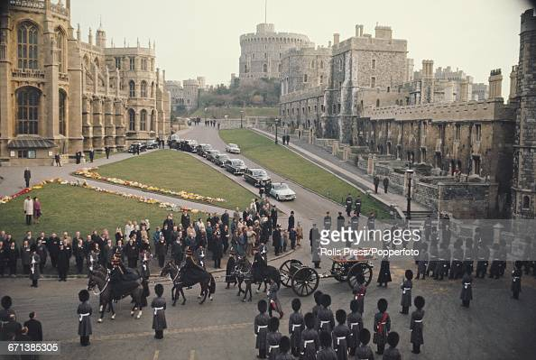 View of the funeral procession of Field Marshal William Slim 1st Viscount Slim as the casket lying on a gun carriage is pulled by six horses along...