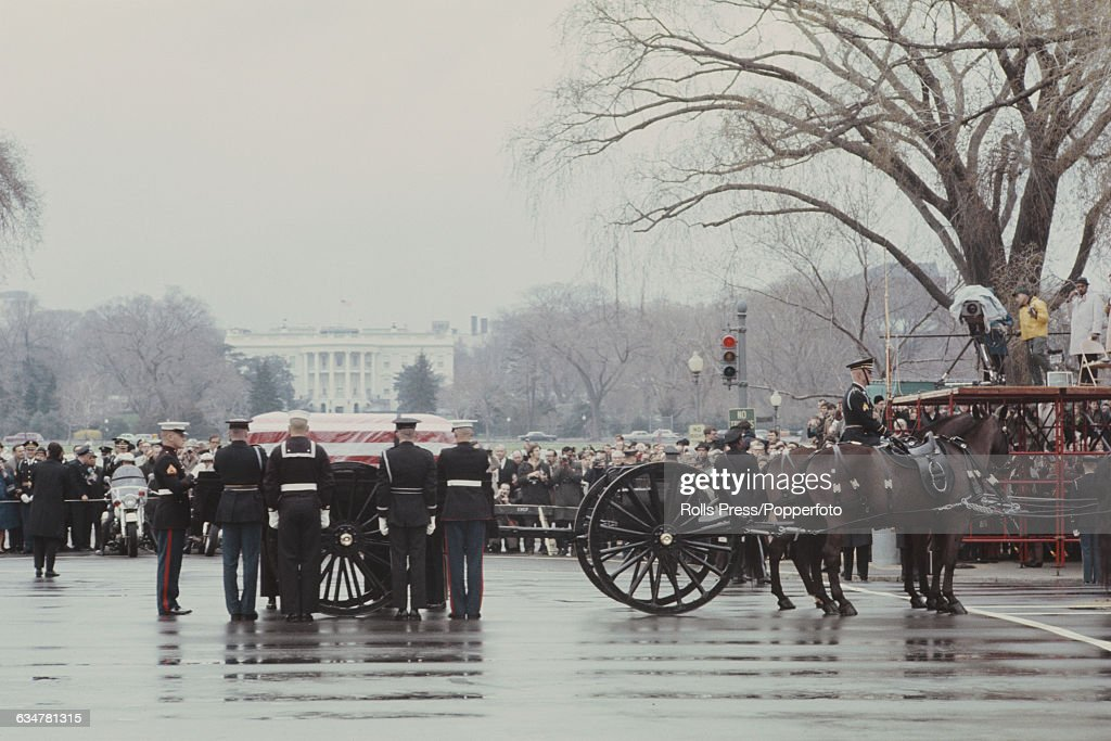 View of the funeral procession of former American President Dwight D Eisenhower with a horse drawn caisson carrying the body of the former President...
