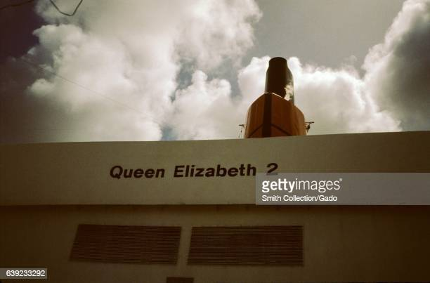 A view of the funnel and the name of the ship aboard the Queen Elizabeth 2 ocean liner 1975