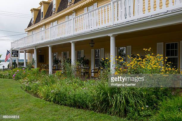 View of the garden and porch of the Robert Morris Inn in Oxford Maryland USA