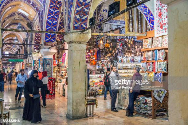 View of the Grand Bazaar, arab lady, and shop owners , Istanbul, Turkey