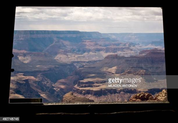 A view of the Grand Canyon trough a window of the Desert View Watchtower built at the edge of the canyon South Rim in Arizona on May 11 2014 Each...
