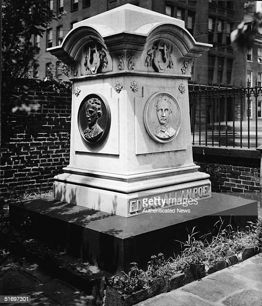 View of the grave of writer Edgar Allan Poe in the cemetery surrounding Westminster Presbyterian Church Baltimore Maryland circa 1949 The gravestone...