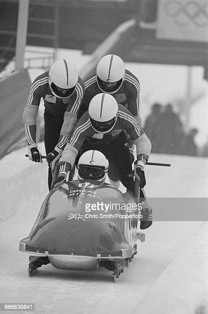 View of the Great Britain 1 fourman bobsleigh team of Mike Pugh Tony Wallington Corrie Brown and Mark Tout in action at the start of competition to...