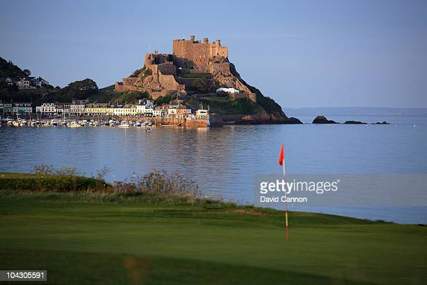 A view of the green on the 470 yards par 5 1st hole accross the bay to The Mont Orgueil Castle and the village of Gorey at The Royal Jersey Golf Club...