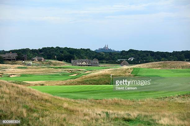 A view of the green on the 607 yards par 5 seventh hole with the 663 yards par 5 18th hole behind looking towards the clubhouse at Erin Hills Golf...
