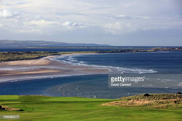 A view of the green on the 6th hole with the castle and island of Lindisfarne behind at Bamburgh Castle Golf Club on October 6 2010 in Bamburgh...