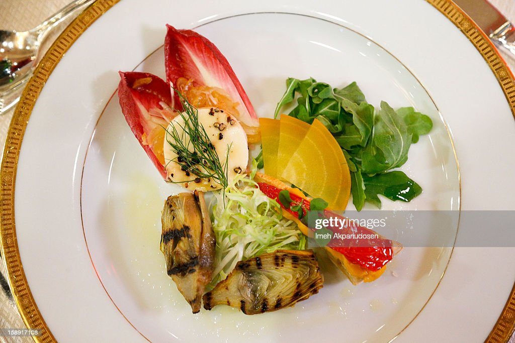 A view of the grilled artichoke with fennel tomato lemon mousse and California pepper honey goat cheese on endive pear salad appetizer prepared by executive chef Suki Sugiura for the 2013 Golden Globe Awards at The Beverly Hilton Hotel on January 3, 2013 in Beverly Hills, California.