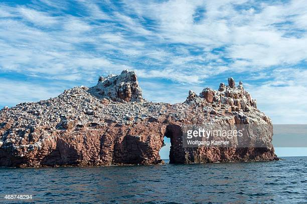 View of the guano covered Los Islotes Islands with arch in the Sea of Cortez in Baja California Mexico