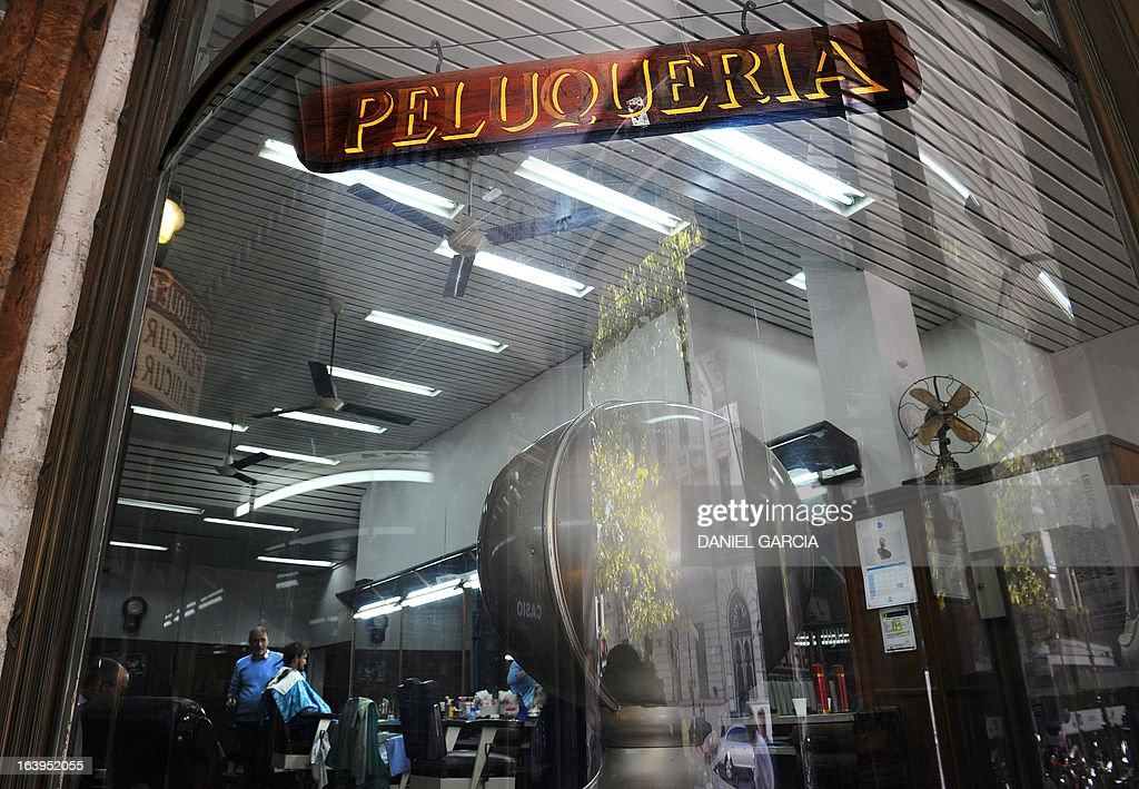 View of the hairdressing and pedicure salon Romano, founded on 1969, in downtown Buenos Aires, pictured on March 18, 2013. The salon is located about one block from the Buenos Aires Cathedral, and is where the new Pope Francis used to get his hair cut and feet taken care of when he was bishop and archbishop of the Argentine capital. AFP PHOTO/DANIEL GARCIA