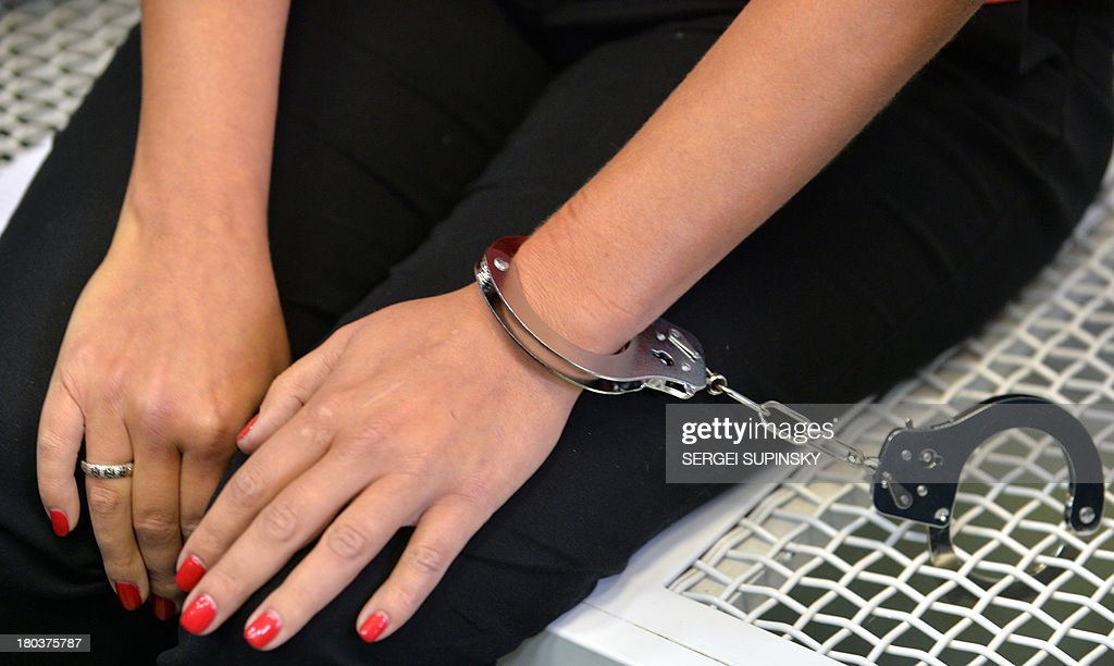 A view of the hand of one of three HIV-infected patients of the specialized Lavra hospital in Kiev who remain handcuffed to the steel frame of a bed as they start an unlimited protest against a government decision to force the closing and relocation of the HIV patients care unit, on September 12, 2013. The three patients and some employees of the unique Ukrainian hospital unit are protesting the Ukrainian government's decision to close the unit and relocate it outside of the city center saying the new location does not fit the standards for proper treatment. Ukraine has one of the fastest growing HIV/AIDS epidemics in the world. AFP PHOTO/ SERGEI SUPINSKY