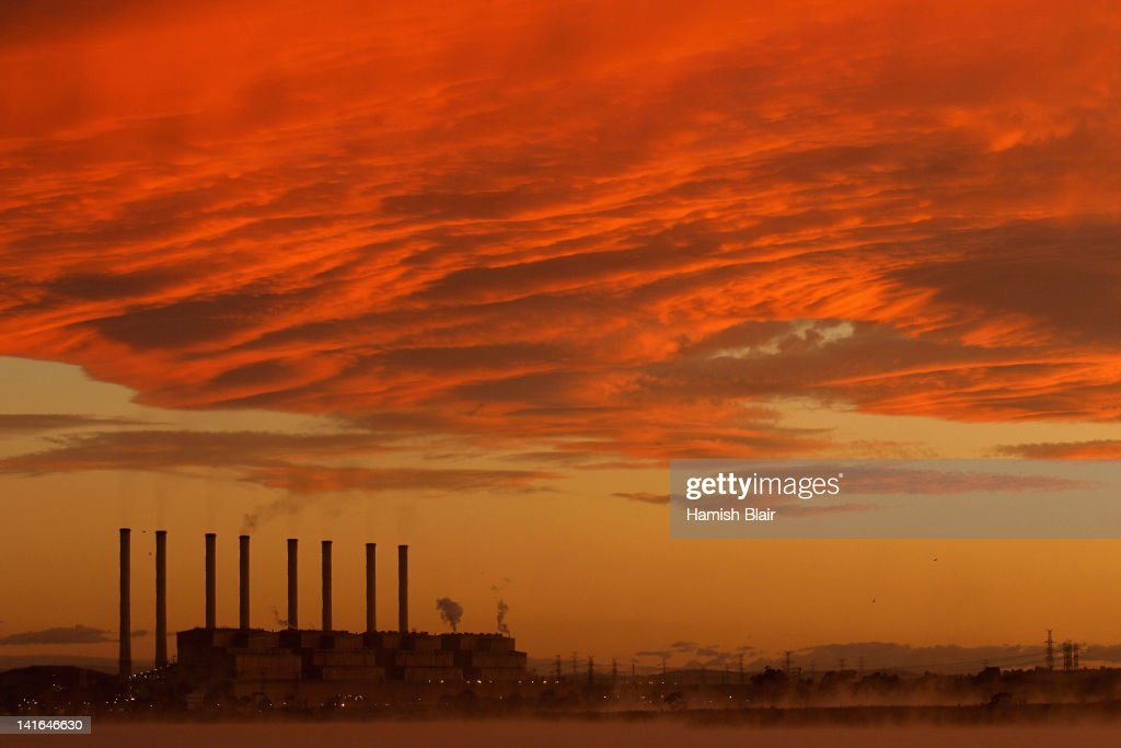 A view of the Hazelwood Power Station across the cooling pondage at sunrise on March 21, 2012 in Melbourne, Australia. The brown coal fueled power station, located in Latrobe Valley is the oldest in Victoria and provides the state nearly 25% of its energy. In 2005 Hazelwood was labeled Australia's least carbon efficient power station by WWF Australia and continues to be a target of issue of environmentalist groups.