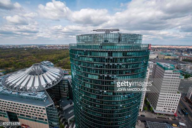 View of the headquarters of German railway giant Deutsche Bahn next to the Sony Centre at Berlin's Potsdamer platz on April 20 2017 / AFP PHOTO /...