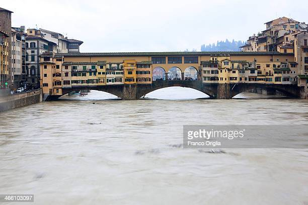 A view of the high water levels on the Arno River at Ponte Vecchio bridge on January 31 2014 on Florence Italy Many areas of central and northern...