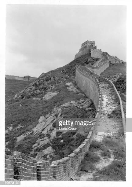 A view of the highest point of the Great Wall of China in the vicinity of Peiping surmounted by a watch tower at the top of a long steep ramp The...