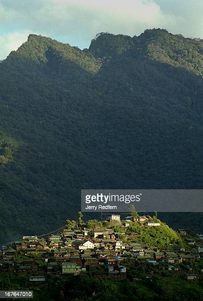A view of the hilltop town Khonoma as seen from Mezoma village on a nearby hill top Naga villages were traditionally built atop hills the better to...
