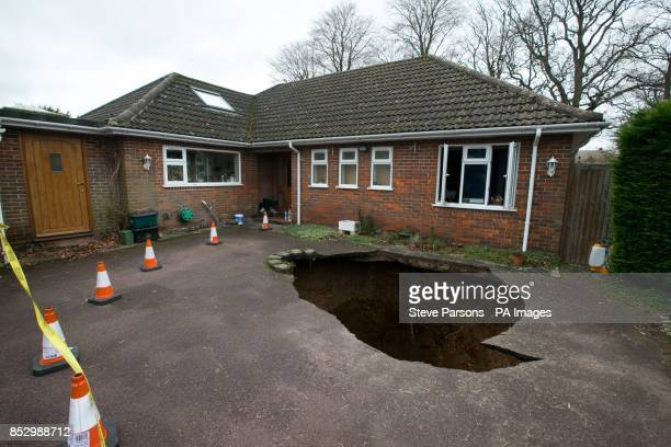 A view of the home of Phil and Liz Conran in Main Road Walter's Ash High Wycombe Buckinghamshire after a 30ftdeep sinkhole opened up in the driveway...