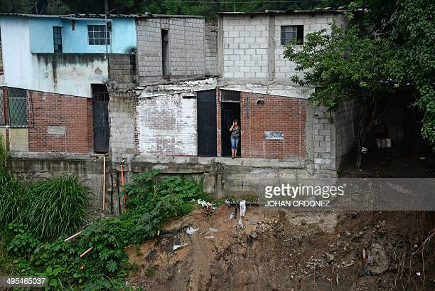 View of the homes at risk after part of one collapsed due to heavy rains in Villa Hermosa San Miguel Petapa municipality 20 km south og Guatemala...