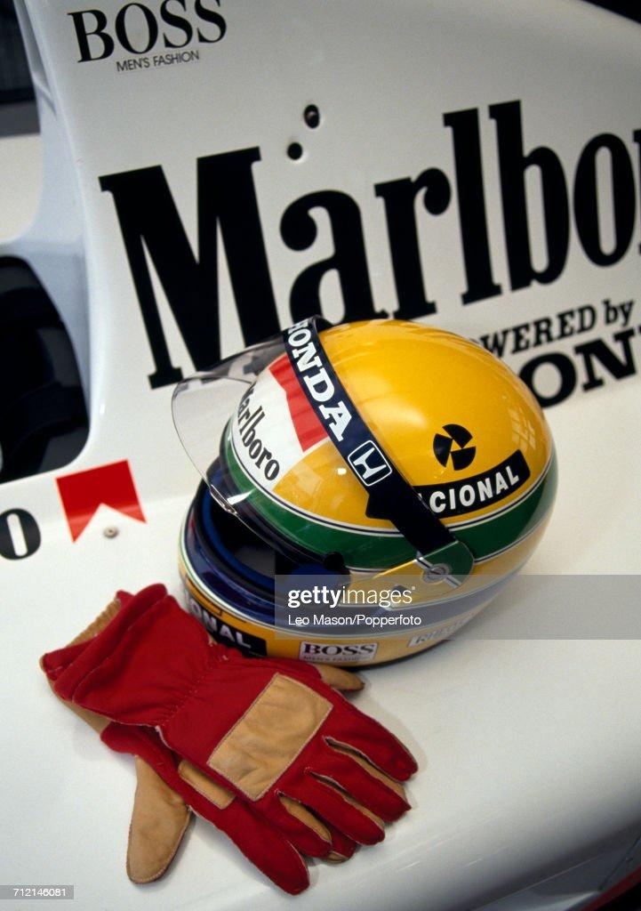 View of the Honda Marlboro McLaren McLaren MP4/6 Honda RA121E 3.5 V12 racing car, gloves and helmet of Formula One driver Ayrton Senna of Brazil in Jerez, Spain, circa February 1991.