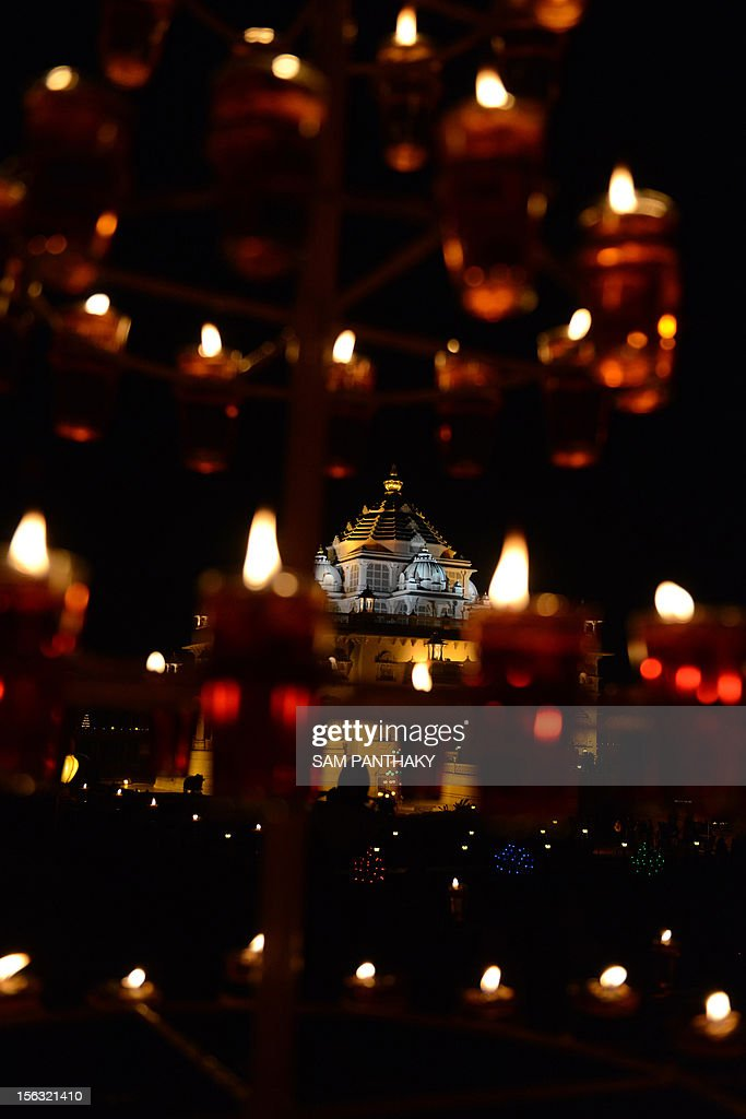 A view of the illuminated Akshardham Temple in Gandhinagar, some 30 kms from Ahmedabad, on the occasion of Diwali on November 13, 2012. The Akshardham Temple is lit with thousands of oil lamps which will continue until November 18. The Hindu festival of light, Diwali, marks the homecoming of the God Lord Ram after vanquishing the demon king Ravana and symbolises taking people from darkness to light and the victory of good over evil. AFP PHOTO / Sam PANTHAKY