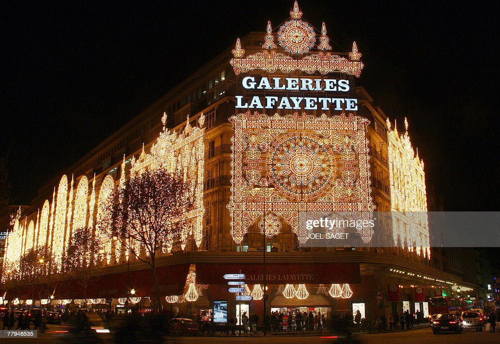 View of the illuminated facade of the Galeries Lafayette department store in Paris, taken 16 November 2007. The famous Parisian store displays also animated shop windows in preparation for Christmas and New Year celebrations. AFP PHOTO JOEL SAGET