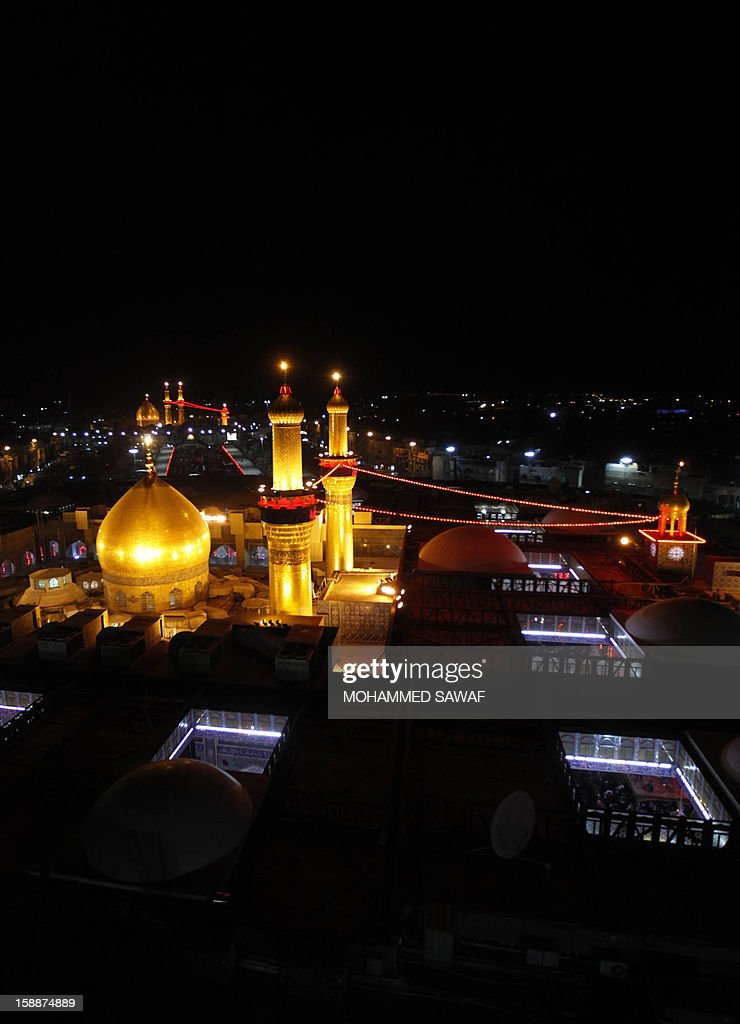 A view of the Imam Hussein shrine and Imam Abbas shrine in the city of Karbala, southwest of Iraq's capital Baghdad, as Shiite Muslim pilgrim gather for the Arbaeen religious rituals which marks the 40th day after Ashura commemorating the seventh century killing of Prophet Mohammed's grandson, Imam Hussein, on January 2, 2013. AFP PHOTO/MOHAMMED SAWAF