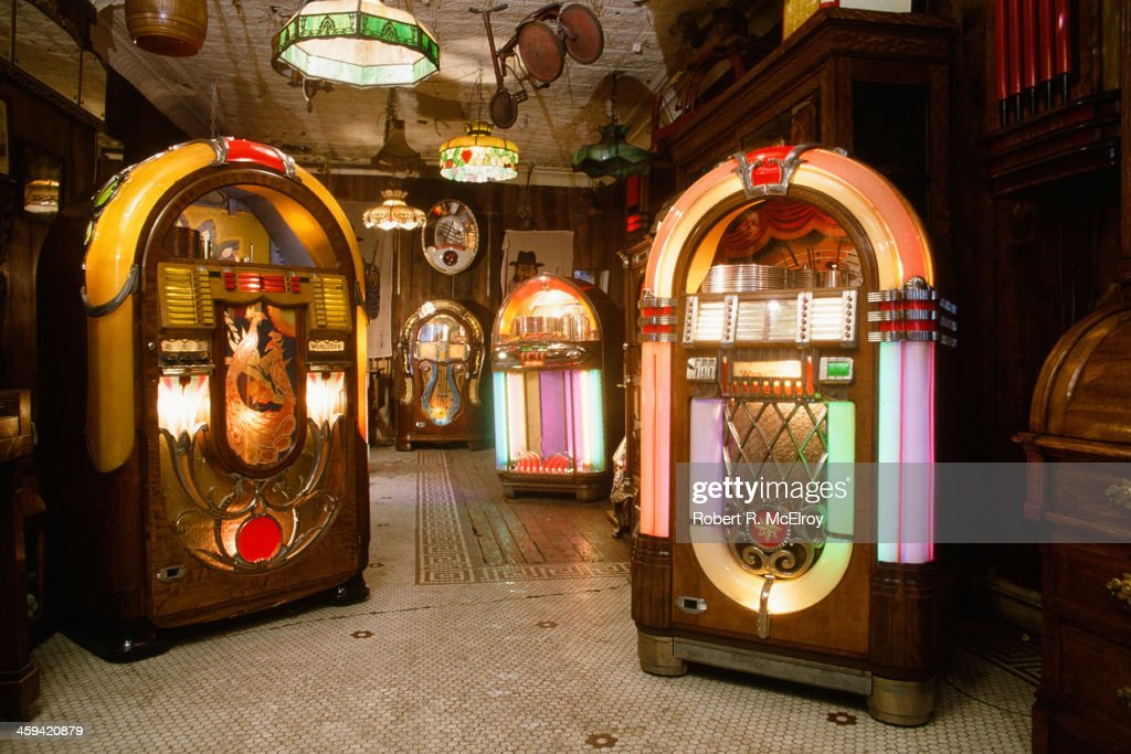 View of the interior of Back Pages Antiques, a store with a strong jukebox collection, New York, 1982.