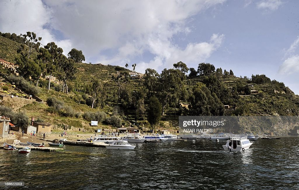View of the Isla del Sol during the VII International Open Water Swimming Tournament at the Titicaca Lake, Bolivia, on May 12, 2013. In the competition, swimmers from Chile, Argentina, Perú, Brazil and Bolivia cross a 7km distance between the Isla del Sol and the Isla de la Luna, at 3841 mt above sea level and 12° C (53.6°F) temperature. AFP PHOTO / Aizar Raldes