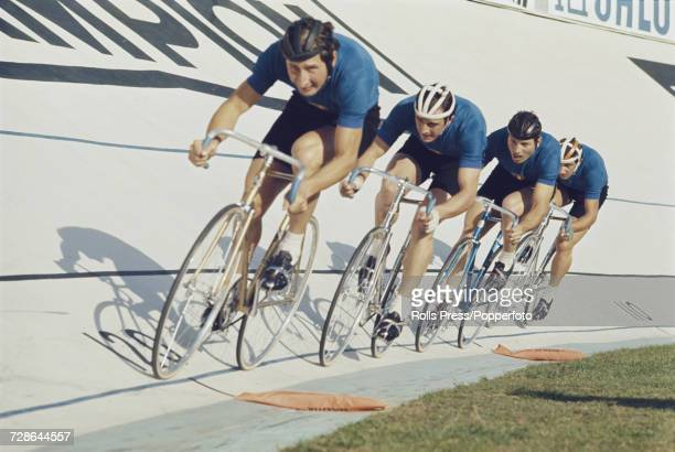 View of the Italian men's team pursuit team pictured in action together during competition in the Men's team pursuit event at the 1970 UCI Track...