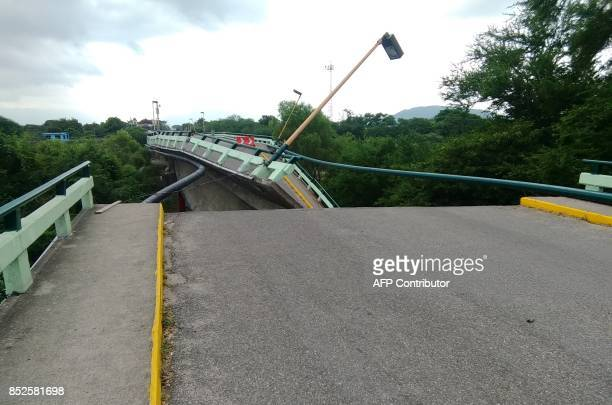 View of the Ixtlaltepec bridge collapsed by a 61magnitude earthquake in Ixtlatepec Oaxaca state Mexico on September 23 2017 Efforts to find life...