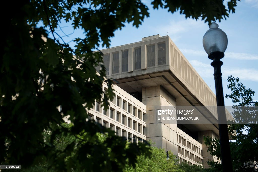 A view of the J. Edgar Hoover Building, the headquarters for the Federal Bureau of Investigation (FBI), on May 3, 2013 in Washington, DC. The FBI announcement that it will move its headquarters has sparked fierce competion in the Washington DC area withe bordering states Maryland and Virginia competing to have the FBI find a new home in their states. AFP PHOTO/Brendan SMIALOWSKI