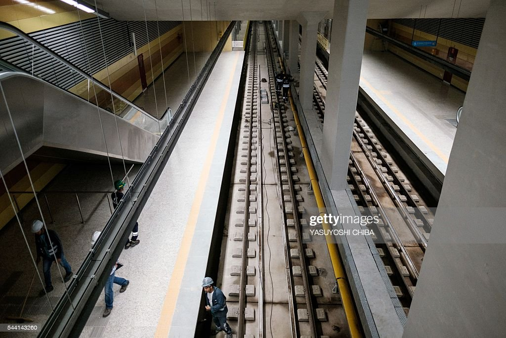 View of the Jardim Oceanico metro station (Line 4) under construction, closest to the Olympic Park in Barra da Tijuca, west zone of Rio de Jnaeiro, Brazil, on July 1, 2016. / AFP / YASUYOSHI