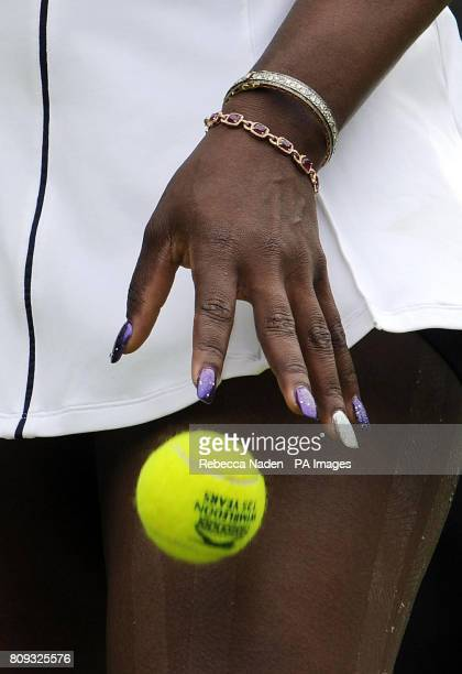 A view of the jewellery and nail varnish worn by USA's Serena Williams in her match against France's Aravane Rezai during day two of the 2011...