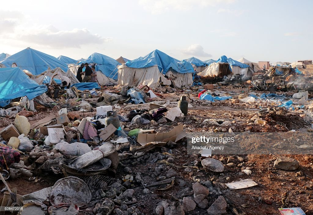 A view of the Kamuna refugee camp damaged after a Syrian regime warplane targeted Kamuna refugee camp near the Syrian town of Sarmada town in the Idlib province after Syrian regime warplane targeted the camp on May 05, 2016. Eight people were killed and another 30 injured when a regime warplane targeted the Kamuna refugee camp.