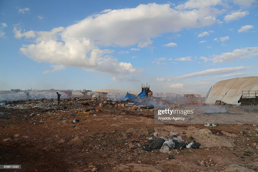 A view of the Kamuna refugee camp damaged after a Syrian regime warcraft targeted Kamuna refugee camp near the Syrian town of Sarmada town in the Idlib province after Syrian regime warplane targeted the camp on May 05, 2016. Eight people were killed and another 30 injured when a regime warplane targeted the Kamuna refugee camp.