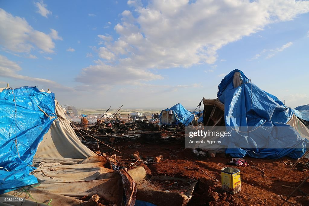 A view of the Kamuna refugee camp damaged after a Syrian regime warcraft targeted Kamuna refugee camp near the Sarmada town of Idlib province, Syria on May 05, 2016. Eight people were killed and another 30 injured when a regime warcraft targeted the Kamuna refugee camp.